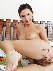 Efina loves to play with her hairy pussy