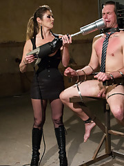 Business man learns the rules of a hot dominatrix