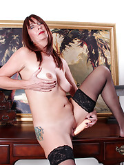 Horny Anilos Lily shoves a stiff dildo deep into her shaved juicebox