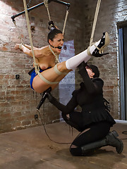Lyla Storm endures a no holds intense HogTied Live Show. Suspended in a strappado ball, spread eagle back arch, and extreme forward bend suspension!