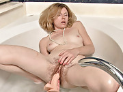 Lacey gets ready to give her hairy pussy a bath