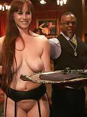 House slaves serve a lounge full of kinky, horny guests