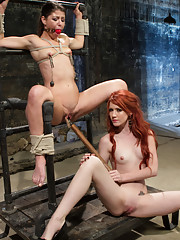 Hot redhead dominatrix, Elle Alexander dominates and ass fucks lesbian with a perfectly round ass!