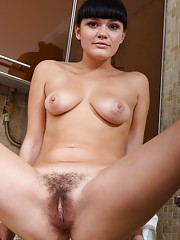 Elicia loves pulling her hairy pussy apart