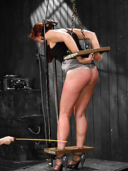 Ginger Josi Valentine is repeatedly trapped and bifurcated in challenging flexibility bondage, intense pain play, and used for her cunt.