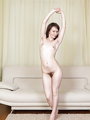 Mary strips on her couch, fondles her hairy pussy