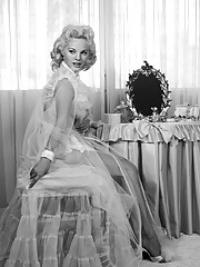 A visit with a Playmate too shy to become a star. It may be difficult to believe, but the girl pictured so personally here is extremely shy. These intimate photographs of Miss December 1956 Lisa Winters preparing for�