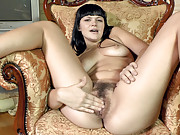 Elicia loves playing with her pretty hairy pussy