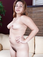 Voluptuous Daisy Leon shows off her hairy pussy