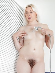 Hairy babe Alison Colins is in the shower