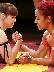 This is a tag match on a temporary set. The US girls are ready and willing to fight on any mat any time, anywhere!!!