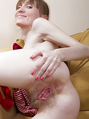Gela loves red and playing with her hairy pussy