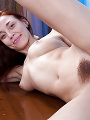 Arina spreads her legs for a hairy pussy view