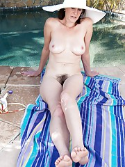 Veronica Snow shows her hairy pussy in the pool
