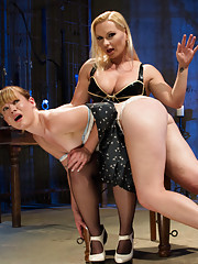 Hot blonde German lesbian dominatrix spanks and whips adorable red haired submissive then strap-on fucks her in the ass.