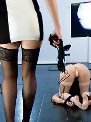 Cute, mousey Missy Minks with her head locked in a pit in the floor is tested with a cattle prod, and electro pussy plus and an intense flogging.