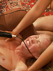 Blonde and Brunette with glasses take hard cock in the ass all night long to amuse the crowd.