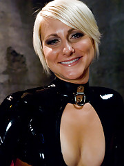 Hot blonde bound in latex and shocked by Claire Adams