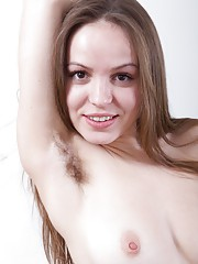 Gretta strips and gives her hairy pussy some air