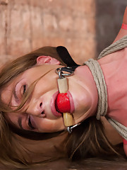When beautiful Cassandra Nix comes to Hogtied, she is bound, humiliated, stuffed and stretched in inescapable rope bondage.