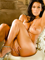Nancy Erminia will cast you under her sexy spell wearing only silver jewelry and a sultry smile.…