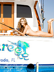 CATCH OF THE DAY  Grab your rod and reel and climb aboard. Falling for Miss February Shawn Dillon�  hook, line and sinker  Photography By Tony Kelly    This time of year, the tropical islands beckon�surf, cold beer,�