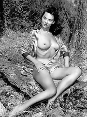 """During the Fifties and early Sixties, Madeline appeared as a pin-up in nearly 100 books and magazines. Her Playmate shot, by Jack and Jean Drebert, features an uninspired pose. As Hefner observes, """"Playboy"