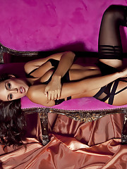 Playmate of the Year Jaclyn Swedberg is on set with photographer Jared Ryder in this sumptuous pictorial. Laid out on an ornate French setée, she's done up in a corseted black bra, panties, thigh-highs and a pair of…