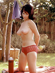 SUMMERTIME IDYL  July Playmate Carrie Enwright is an unspoiled, happy homebody     While it may not necessarily be true, as the song says, that happiness lies under the skies back in one