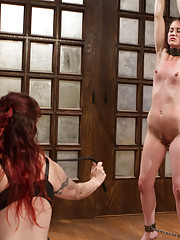 20 year old wallflower is punished, dominated and strap-on ass fucked by HUGE titted lesbian domme!