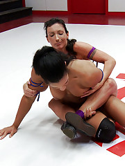 Two strong, muscular women fighting for control on the mats and one must give up the Ultimate Surrender