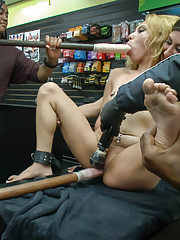 Petite blonde fucked in sleazy sex shop for her 1st ever porn shoot. Bounced around like a blow-up doll then banged through a glory-hole.