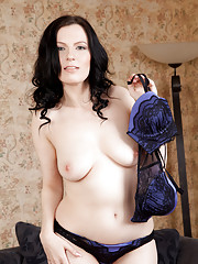 Busty black haired milf caresses her juicy round ass
