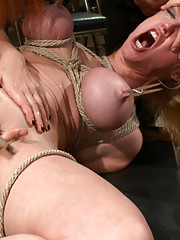 Darling gets fucked on camera for the first time at Kink.com, while a crowd torments her, and she pleasures Mz. Berlin.
