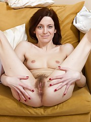 Ginger Alice spreads her hairy pussy