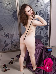 Sexy Olga plays with her fishnets and hairy pussy