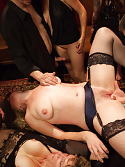 Iona Grace returns as the Consort to keep the slaves in line with hot boy girl girl action on the Upper Floor