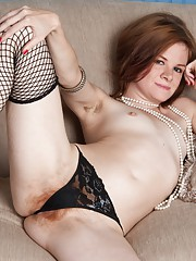 Fishnet stockings and black dress show hot redhead Zia
