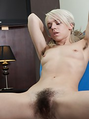 Hairy woman Selena enjoys stripping and playing
