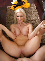 Busty blonde housewife has hot sex in the kitchen.
