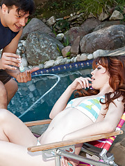 Sexy redhead babe gets fucked by the pool outside.