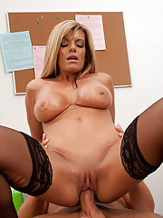Busty blonde worker is horny at works and has hot sex with a co worker.