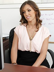 Sexy babe Audrey Rose fucks in her office on her desk.
