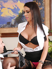 Gorgeous busty brunette worker fucks an employee right on her desk.