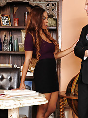 Tori Taylor helps out a coworker by sucking his cock and fucking him in the office.