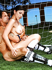 Hot brunette practices her soccer moves before fucking a cock on the field