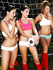 Three sexy girls warm up on the soccer field before taking advantage of the coaches hard dick.