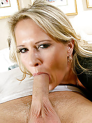 Blonde cougar takes advantage of her young neighbor in the bedroom.