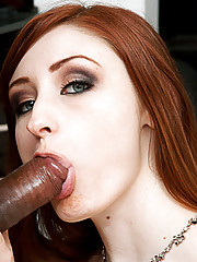 Sexy redhead takes a black cock in the ass.