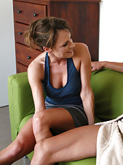 Saskia is a hot milf and she fucks younger cock on the couch.